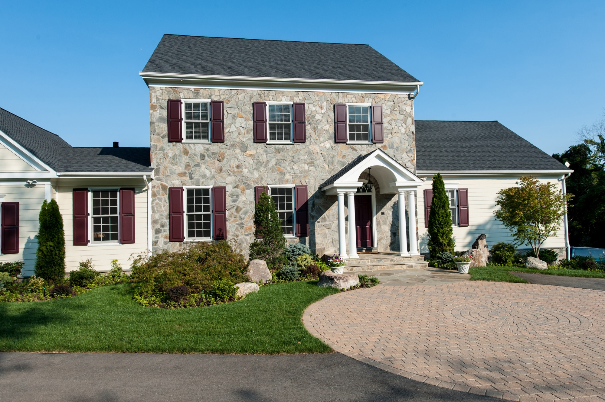 stone front, functional shutters, brick drive