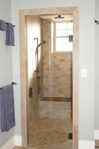 shower with multiple heads and seating
