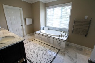 master bath with black and white marble