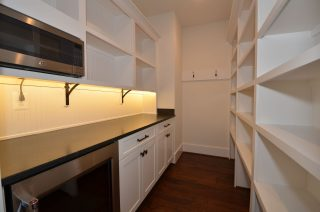 Contemporary Pantry with custom built-ins and stainless steel appliances