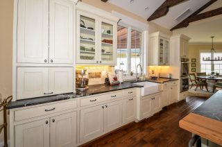 Apron front sink, shaker cabinets, and glass front cabinets