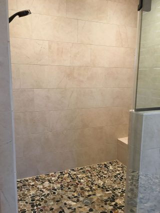 Pebble shower floor in Modern Farmhouse master bath