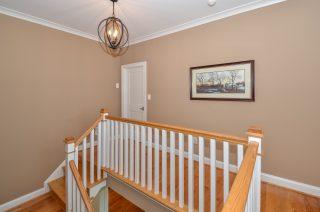 stair rail detail with hardwood floors