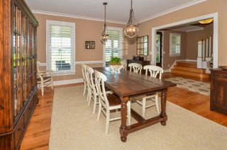 dining room trim and pendants, gorgeous foyer beyond