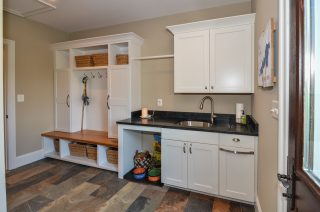 mudroom includes dog-feeding station and built-in cubbies