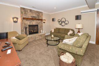 basement fireplace - cut stone and wood mantle