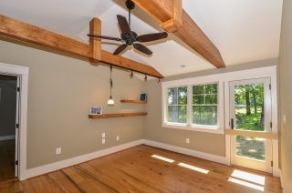 Wood flooring, ceiling beams, and shelving built by Fairhaven from trees cut from the house's property