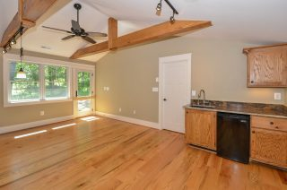 The wood flooring, ceiling beams, and shelving in this office were built by Fairhaven out of trees cut from the house's property.