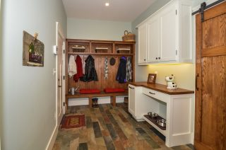 Wood counter and mudroom built-ins made of wood from the house's property